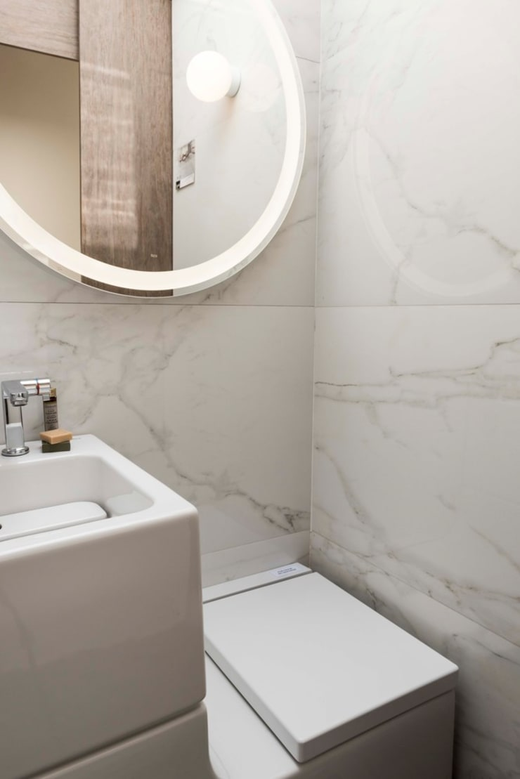 Baño: Baños de estilo  por SUMATORIA,