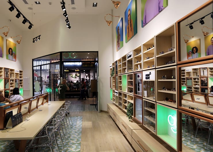 Optica Colombiana, CC Viva Envigado: Espacios comerciales de estilo  por Gamma,