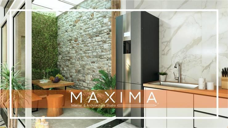 Dapur & Taman Outdoor Pak Tommy – Medan: Taman batu oleh Maxima Studio Medan Interior Design & Arsitek,