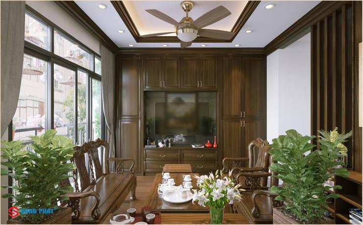 Dự án thiết kế nội thất nhà phố cao cấp với gỗ tự nhiên:  Living room by Công ty TNHH TK XD Song Phát,