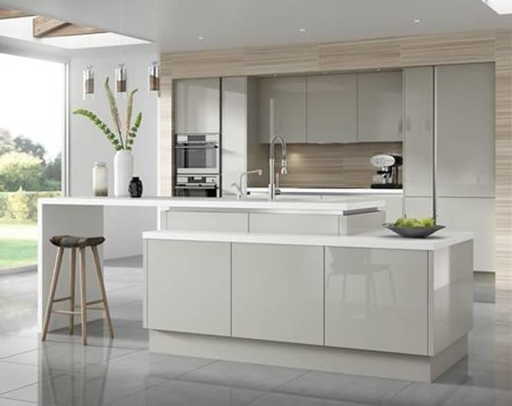 hi gloss impact kitchen with quartz tops:  Kitchen units by ATLAS KITCHENS,