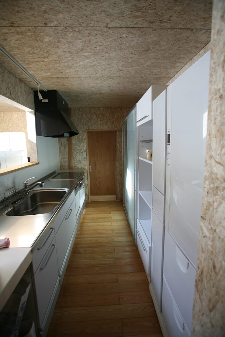 キッチン: 株式会社高野設計工房が手掛けたシステムキッチンです。,