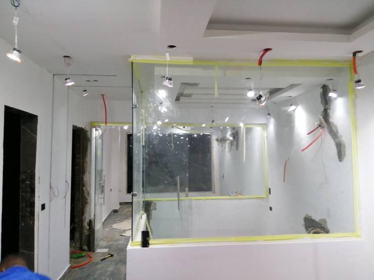 تشطيبات وعمل ديكورات مكتب بالمهندسين مع كاسل لأعمال الديكور والتشطيبات المعمارية:   تنفيذ كاسل للإستشارات الهندسية وأعمال الديكور في القاهرة,