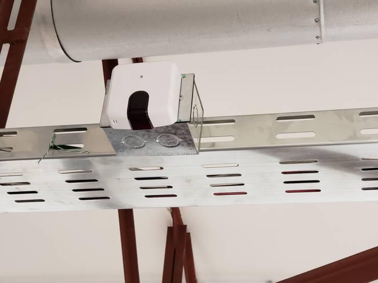Control domótico IR de aire acondicionado:  de estilo  por Control and Automation Solutions SpA -ControlAS,