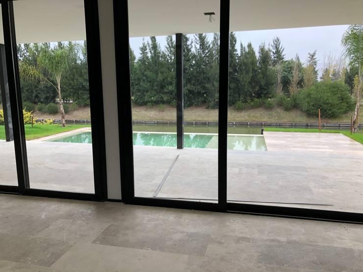 Future House Livings de estilo moderno de Maximiliano Lago Arquitectura - Estudio Azteca Moderno
