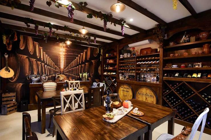 European Influence Villa:  Wine cellar by Da Rocha Interiors, Mediterranean