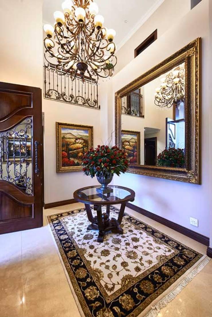 European Influence Villa:  Corridor & hallway by Da Rocha Interiors, Mediterranean