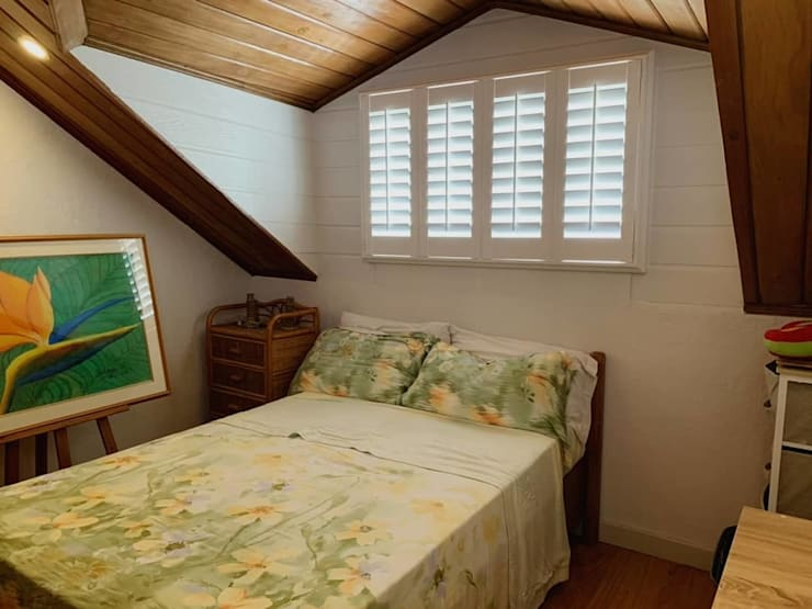 uPVC Plantation Window Shutters on Bedroom:  Small bedroom by LouverWise Inc, Country