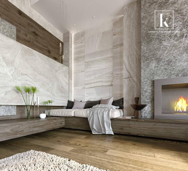 فيلا سكنية:  غرفة المعيشة تنفيذ Karim Elhalawany Studio, حداثي رخام