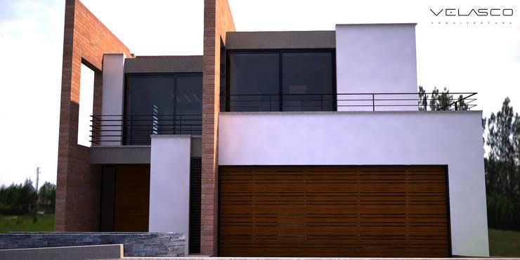 Fachada de acceso: Casas campestres de estilo  por Velasco Arquitectura, Moderno Ladrillos