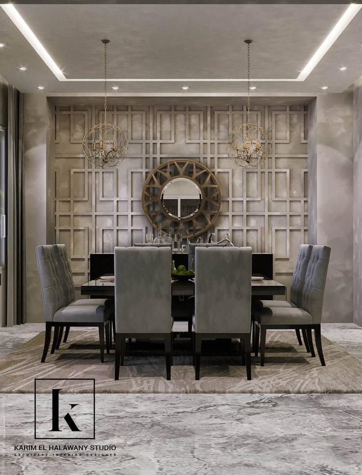 فيلا سكنية:  غرفة السفرة تنفيذ Karim Elhalawany Studio, حداثي