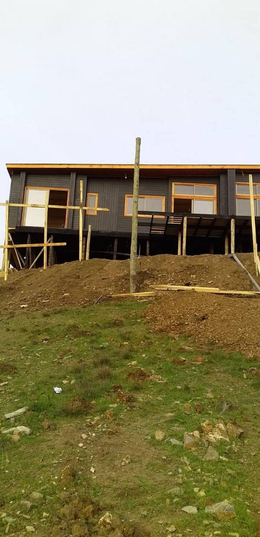 casa cahuil, chacurra: Casas de madera de estilo  por Q-bo proyectos de construccion, Moderno Madera Acabado en madera