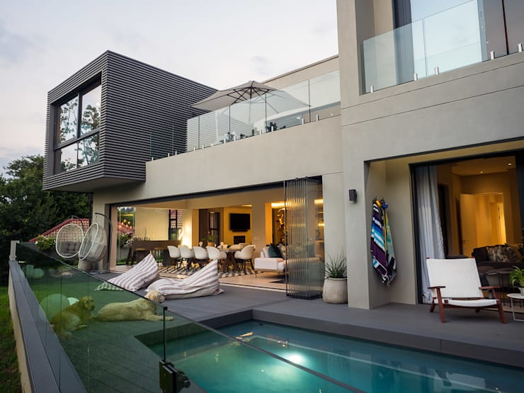 Exterior view over pool:  Garden Pool by DOWN to Earth Architects & Interiors, Modern Wood Wood effect