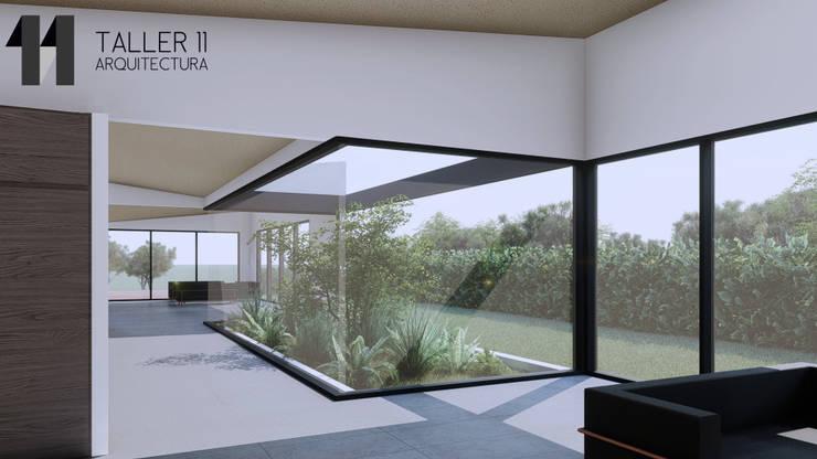 Vista interior jardín: Jardines de estilo  por Taller Once Arquitectura, Minimalista