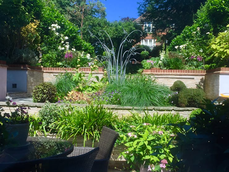 Terraced garden Surrey UK:  Garden by 1 to one garden design, Eclectic