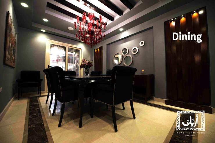 Villa In MiViDa:  غرفة السفرة تنفيذ  Ariaf Authentic Design House, صناعي