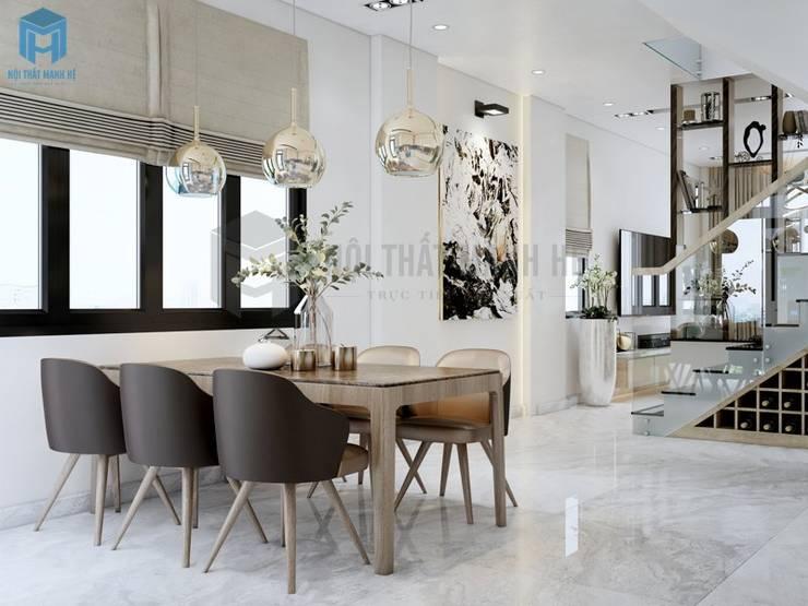 Khoảng không gian kết nối giữa phòng khách và bếp ăn có màu sắc tươi tắn trang nhã:  Phòng ăn by Công ty TNHH Nội Thất Mạnh Hệ, Hiện đại Đá hoa cương