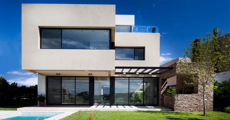 Angola House:  Single family home by Wentworth Construction, Minimalist Concrete