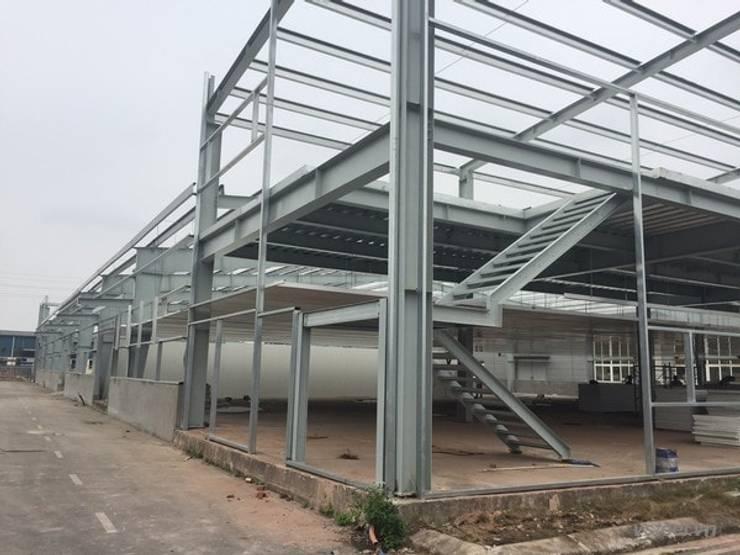 Nhà xưởng công ty Woosung vina:  Nhà để xe tiền chế by Công ty CP Nhà thép Việt Nam, Công nghiệp Sắt / thép