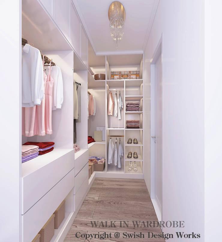 Walk-in wardrobe by Swish Design Works Modern Plywood