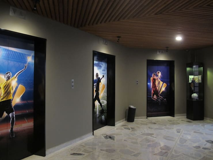 Intervención Hall de ascensores Pasillos, vestíbulos y escaleras de estilo industrial de Proyecto Decc S.A.S. Industrial Ladrillos