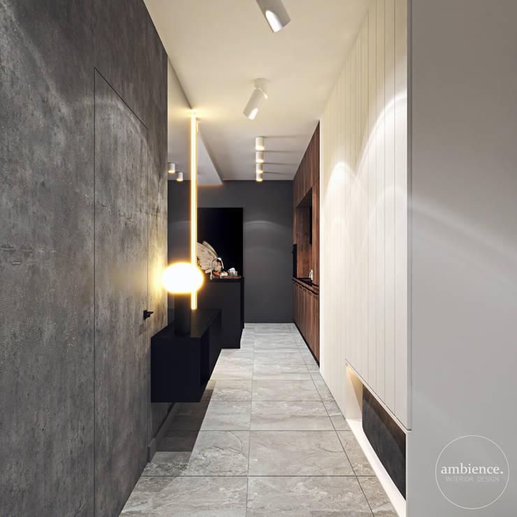 Kontrastowa elegancja Nowoczesny korytarz, przedpokój i schody od Ambience. Interior Design Nowoczesny