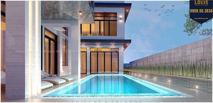 Biệt thự hiện đại kết hợp bể bơi mini bởi Công Ty Thiết Kế Xây Dựng LOUIS