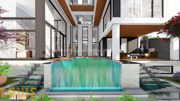 Mẫu biệt thự đẹp có bể bơi trong nhà bởi Công Ty Thiết Kế Xây Dựng LOUIS
