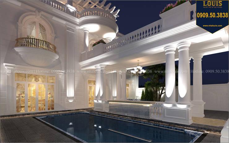 Biệt thự đẹp có bể bơi phong cách tân cổ điển bởi Công Ty Thiết Kế Xây Dựng LOUIS