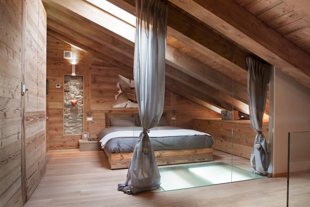 UN CALDO CHALET DI  DESIGN : Camera da letto in stile  di archstudiodesign