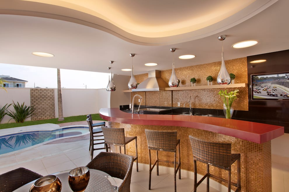 Piletas de estilo  por Designer de Interiores e Paisagista Iara Kílaris