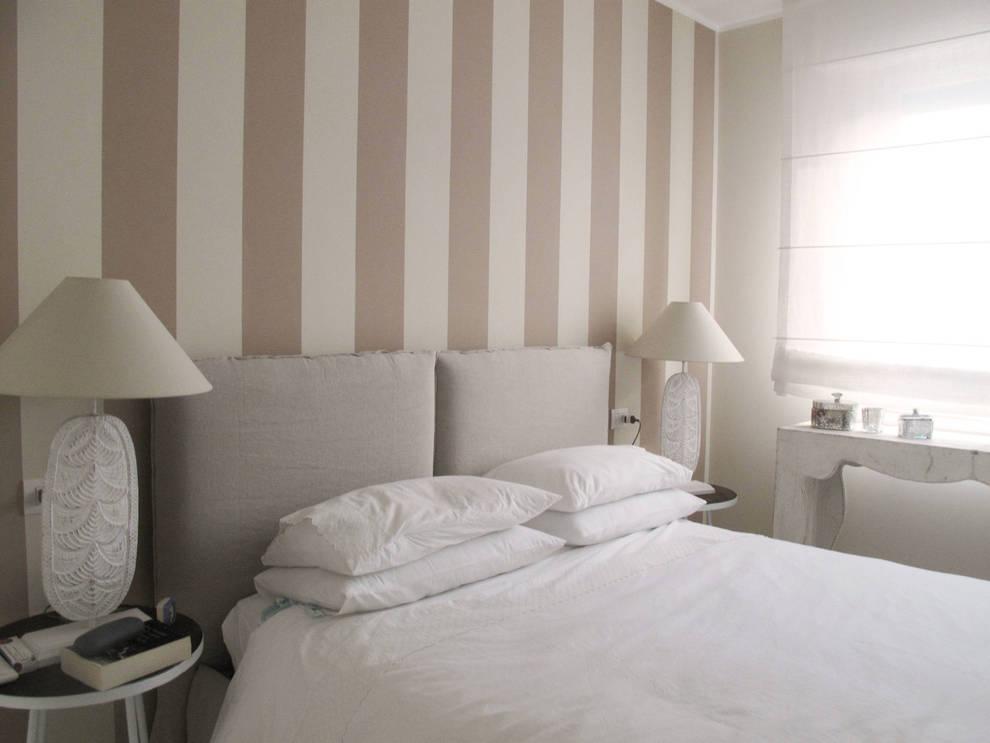 casa Fioriv: Camera da letto in stile  di Studio Matteoni