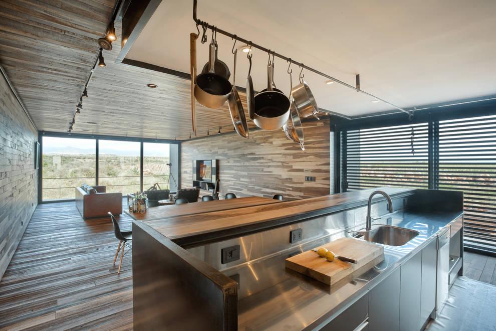 Casa Evans: Cocinas de estilo  por A4estudio