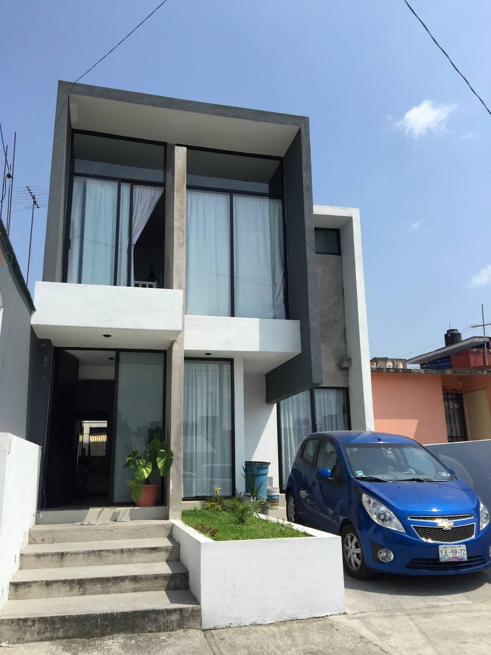 Casas de estilo  por Neutral Arquitectos