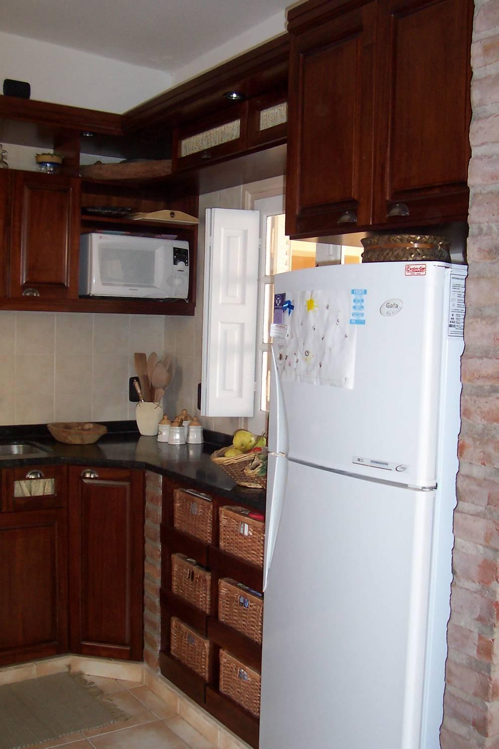 Cucina in stile in stile Rustico di milena oitana