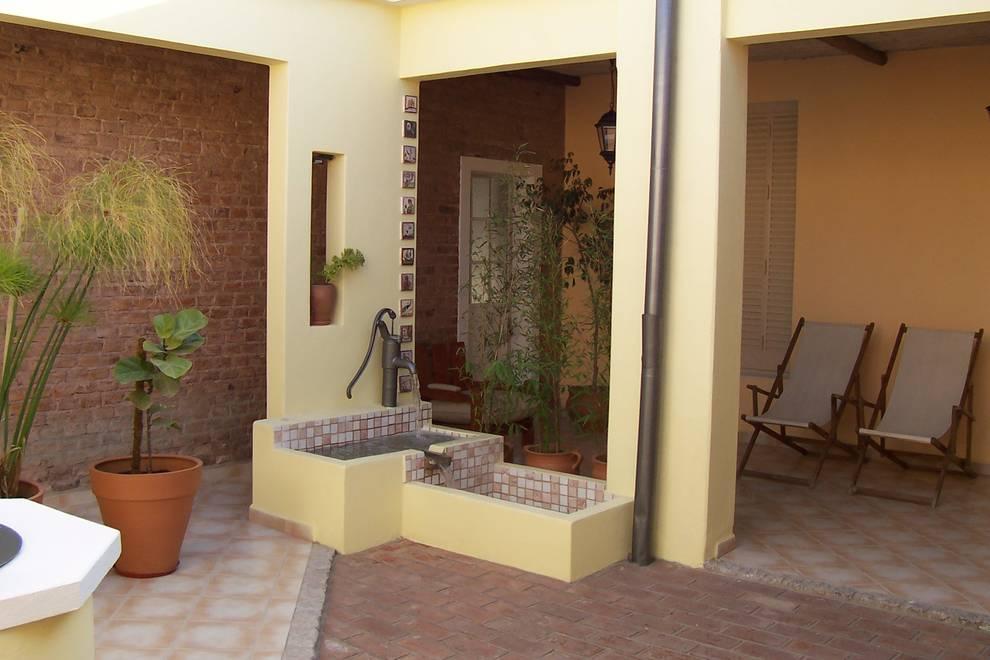 Giardino in stile in stile Rustico di milena oitana