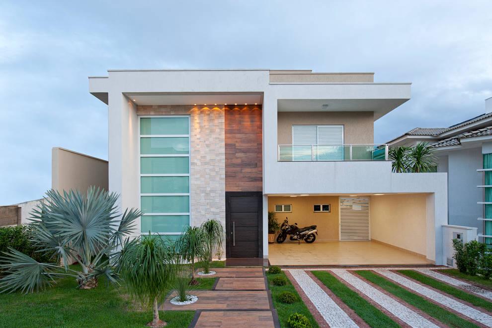 Case in stile in stile Minimalista di Livia Martins Arquitetura e Interiores