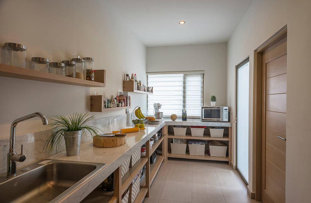 Cozinhas modernas por ROMERO DE LA MORA