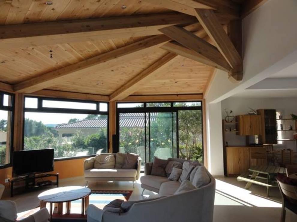 Une véranda panoramique à Puget/Argens :  de style  par Agence TRIHAB