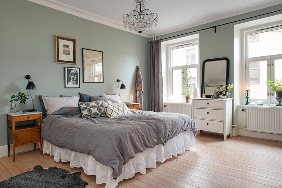 Nordland: Dormitorios de estilo escandinavo por Lumelaria