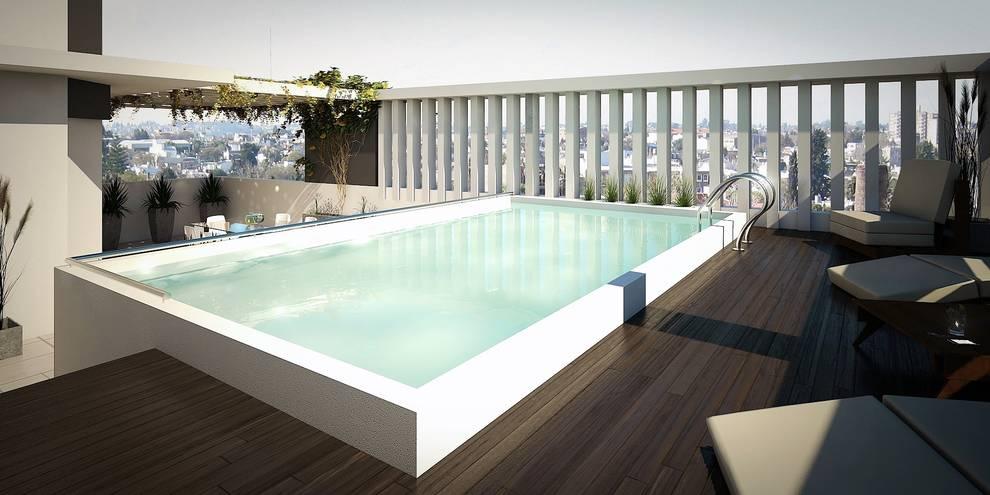 Terraza: Piletas de estilo  por Arcadia Arquitectura