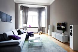 Altbauwohnung Bremen: klassische Wohnzimmer von schulz.rooms