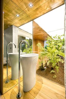Baños de estilo rústico por Egue y Seta