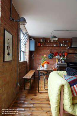 Comedores de estilo industrial por Cassidy Hughes Interior Design