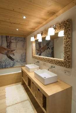 Baños de estilo rústico de Raumkonzepte Peter Buchberger