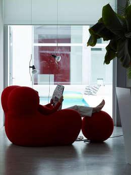 Loft BA: Soggiorno in stile  di Buratti + Battiston Architects