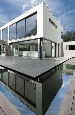 Projekty, nowoczesne Domy zaprojektowane przez AR Design Studio