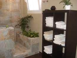 Baños de estilo rústico por Tatiana Doria,   Diseño de interiores