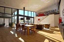 1-Einfamilienhaus: ausgefallene Esszimmer von vollmilch. Das Architekturbüro.
