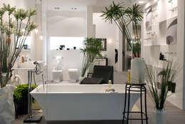 stand Regia : Bagno in stile in stile Moderno di Lucarelli Rapisarda Architettura & Design